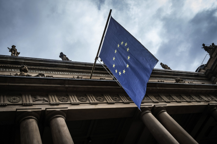A European Union flag hangs outside the Frankfurt Stock Exchange, operated by Deutsche Boerse AG, in Frankfurt, Germany, on April 28. Photo: Bloomberg