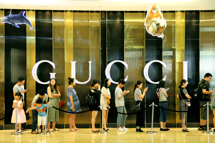 Customers line up outside a Gucci store in Nanjing in June 2016.