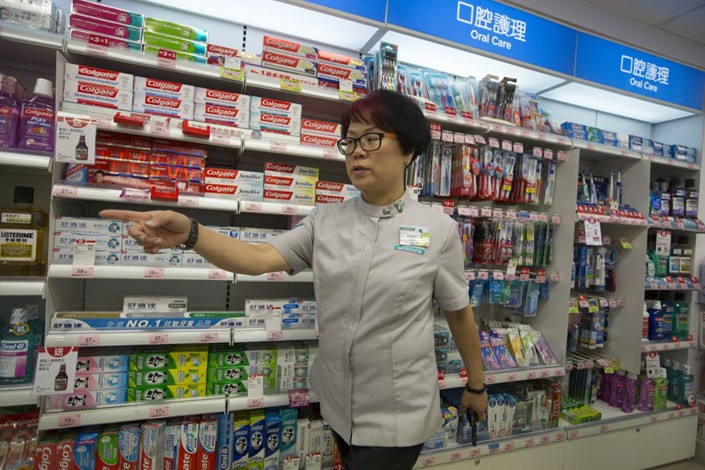 An employee works in a Watsons store in the Tin Hau area of Hong Kong on Oct. 18, 2013.  Photo: Bloomberg