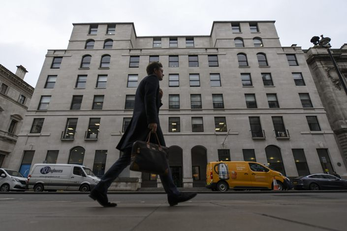 A pedestrian passes 100 Pall Mall, housing the offices of KKR & Co., in London, U.K., on March 10.  Photo: Bloomberg