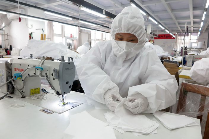 Masks are produced in a clothing company's factory in Qingdao, Shandong province, on June 1.