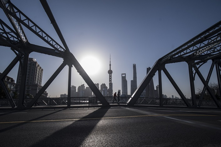 View of Shanghai's Lujiazui financial district at sunrise. Photo: Bloomberg