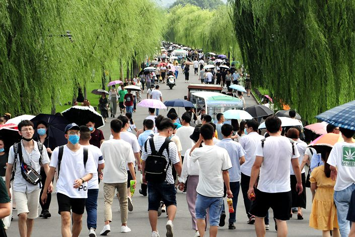 Tourists visit Hangzhou's West Lake scenic area on the second day of the Dragon Boat Festival holiday, June 26.