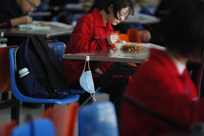 Students eat at a school in Shijiazhuang, capital of North China's Hebei province, on April 23.