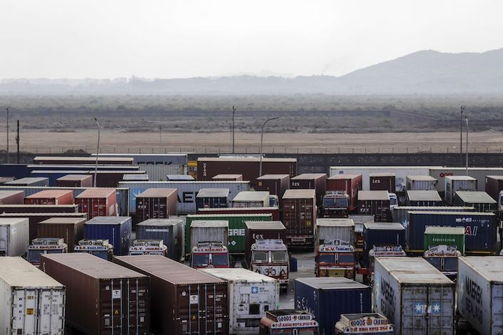 Container trucks sit parked near the Jawaharlal Nehru Port. Photo: Bloomberg
