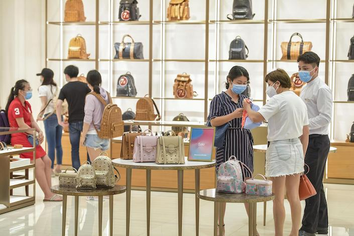 Shoppers in a duty-free store in Hainan.