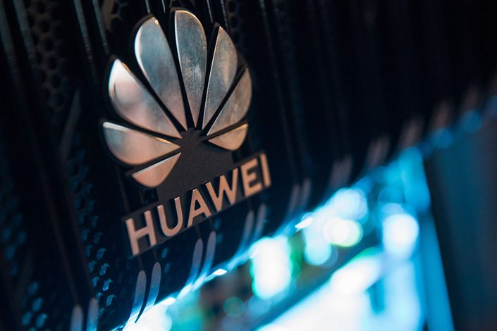 A corporate logo sits on a Huawei Technologies Co. NetEngine 8000 intelligent metro router on display during a 5G event in London, U.K., on Feb. 20. Photo: Bloomberg
