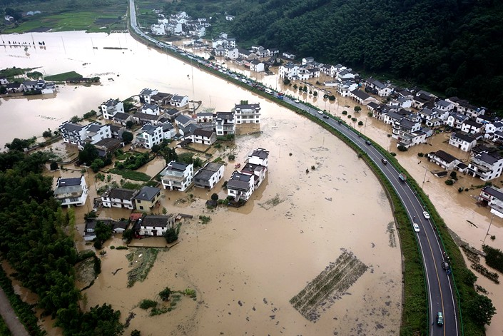 Heavy rain in Huangshan, Anhui province, triggered floods on July 6.