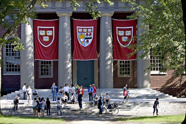 Harvard banners hang outside Memorial Church on the Harvard University campus in Cambridge