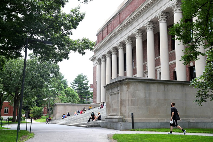 A student walks through the Harvard University campus in Cambridge, Massachusetts, on Wednesday.