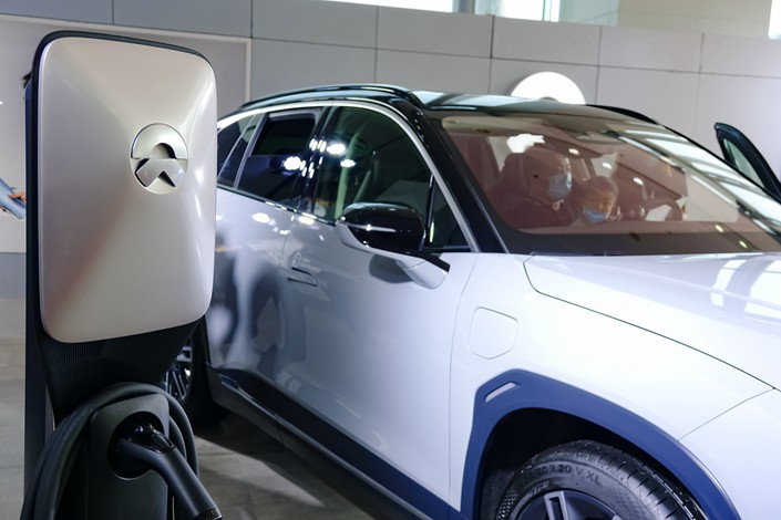 A Nio electric vehicle sits on display on June 25 at an auto show in Qingdao, East China's Shandong province.