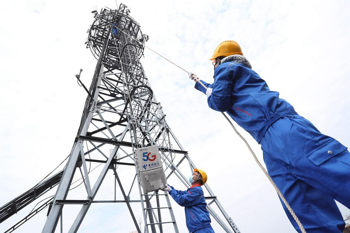 China Telecom workers install a 5G base station in Shanghai on Feb. 21.