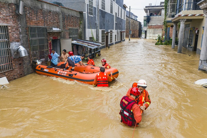 A rescue team saves people trapped in their flooded home in Ji'an city, East China's Jiangxi province, July 10.