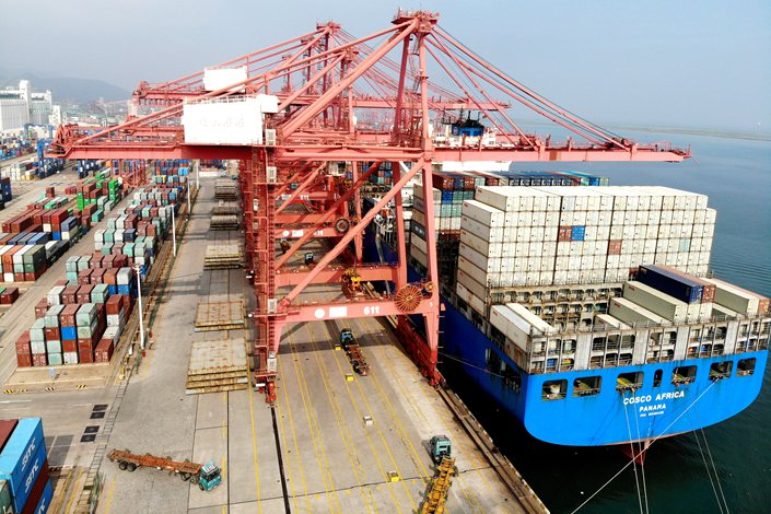 Imported goods get unloaded from a freighter Tuesday at Lianyungang Port in East China's Jiangsu province.