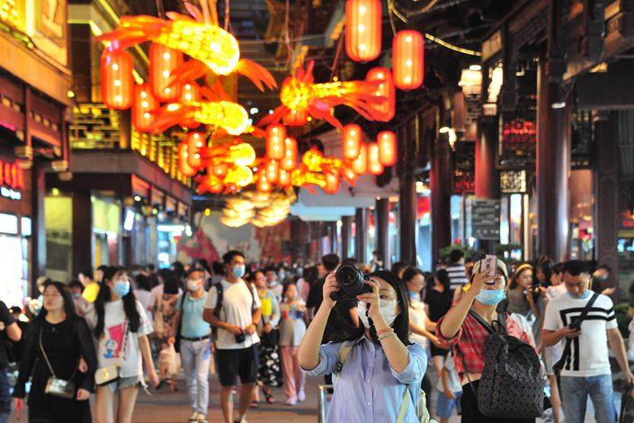 Tourists visit Yu Garden in Shanghai on July 4.