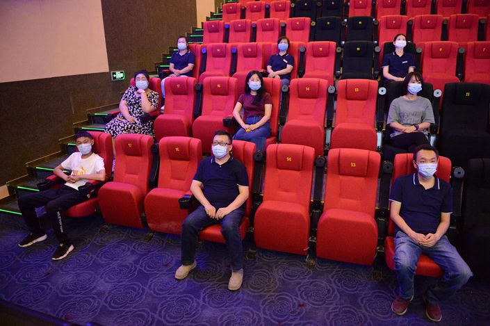 Workers prepare Saturday for movie theaters to reopen in Hohhot in the Inner Mongolia autonomous region.