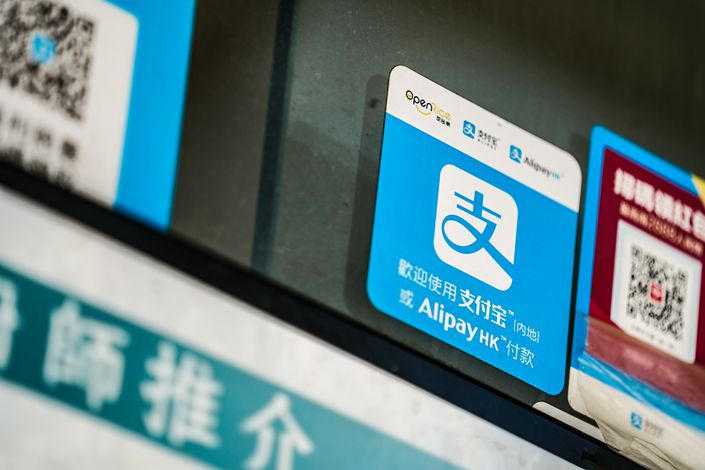A sign for digital payment service Ant Financial's Alipay, an affiliate of Alibaba Group Holding Ltd., is displayed at a store in Hong Kong, on July 21. Photo: Bloomberg