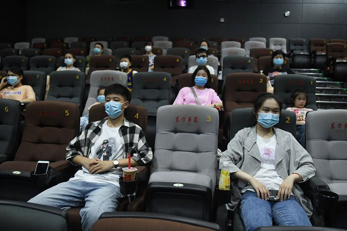 People watch a movie at a reopened cinema in Fuyang, Anhui province, on July 27.
