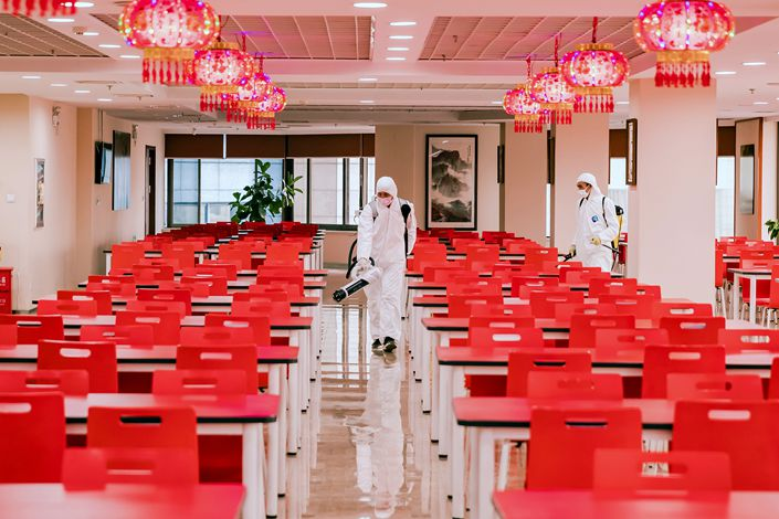 A bank's canteen is disinfected in Dalian, Liaoning province, on July 24.