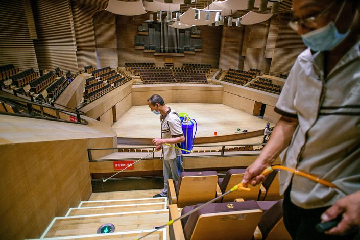 The staff of the Tianjin Grand Theater disinfect the theater on July 27.