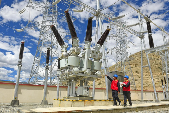 State Grid workers inspect power supply equipment in the Tibet autonomous Region, June 17.
