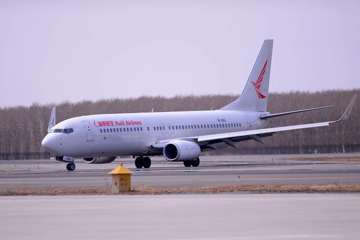 A Ruili Airlines plane parked at Taoxian International Airport in Shenyang, Liaoning Province, March 21.