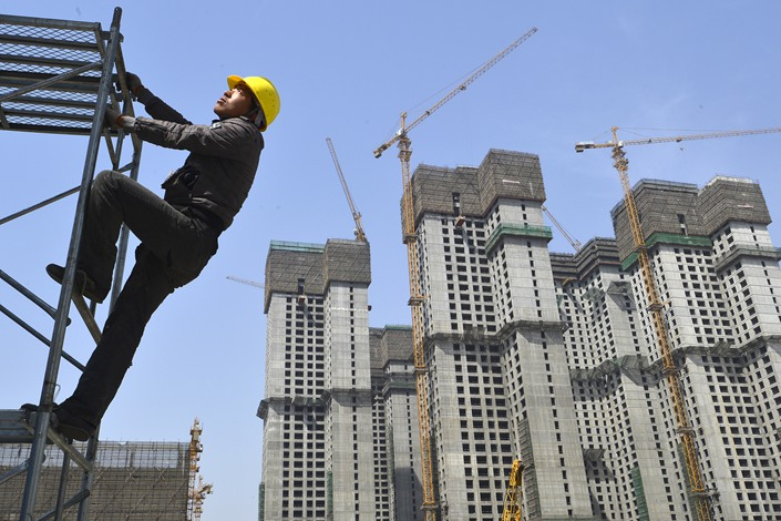 Construction in progress at a housing project in Taiyuan, capital of North China's Shanxi province, July 17.