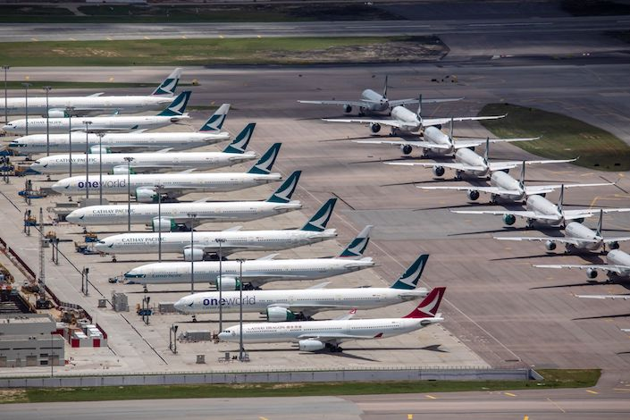 Aircraft operated by Cathay Pacific Airways Ltd. stand on the tarmac at Hong Kong International Airport in Hong Kong