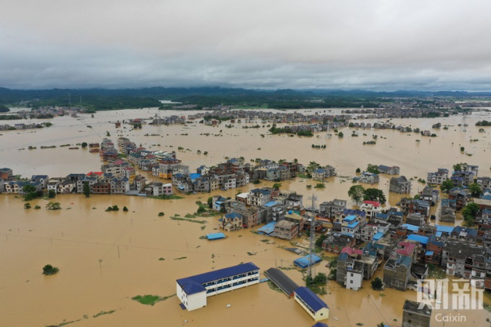 Days of heavy rains leave villages flooded on July 10 in Poyang county, East China's Jiangxi province.
