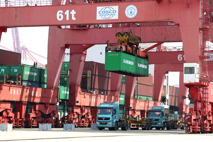 A gantry crane unloads containers Tuesday at the port in Lianyungang, East China's Jiangsu province.