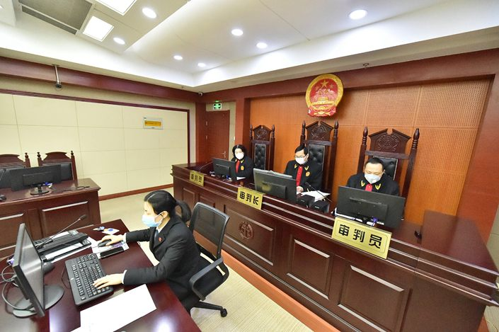 Li told Caixin on Friday that she was still awaiting a formal letter from the prosecutors confirming the case's withdrawal. She did not rule out suing the government for compensation.