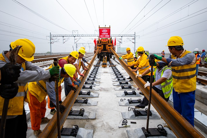 Workers complete construction on the railway linking Beijing and the city's Xiongan New Area on Monday. Photo: IC Photo