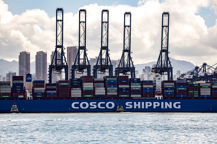 A Cosco Shipping container ship sits at a terminal in Hong Kong on July 27.