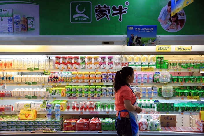 A sign advertises Mengniu Dairy products on June 5 at a store in Nanchang, East China's Jiangxi province.