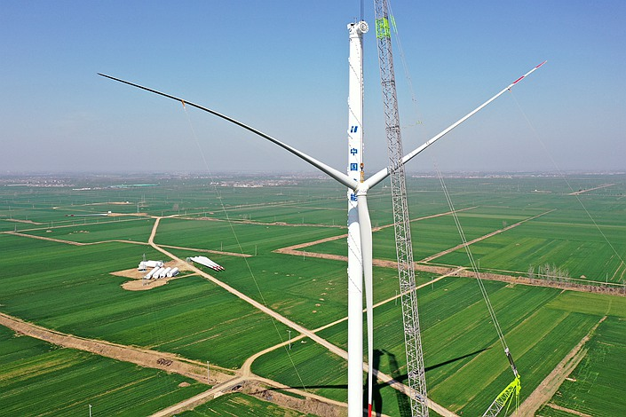 A Huaneng wind turbine in Bozhou city, East China's Anhui Province on March 15.