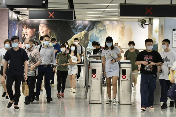 People enter a subway station in Hong Kong on Aug. 14.