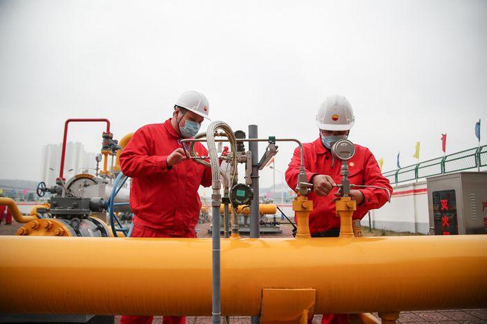 A CNPC employee checks a facility in Guiyang, Guizhou province, on Feb. 20.