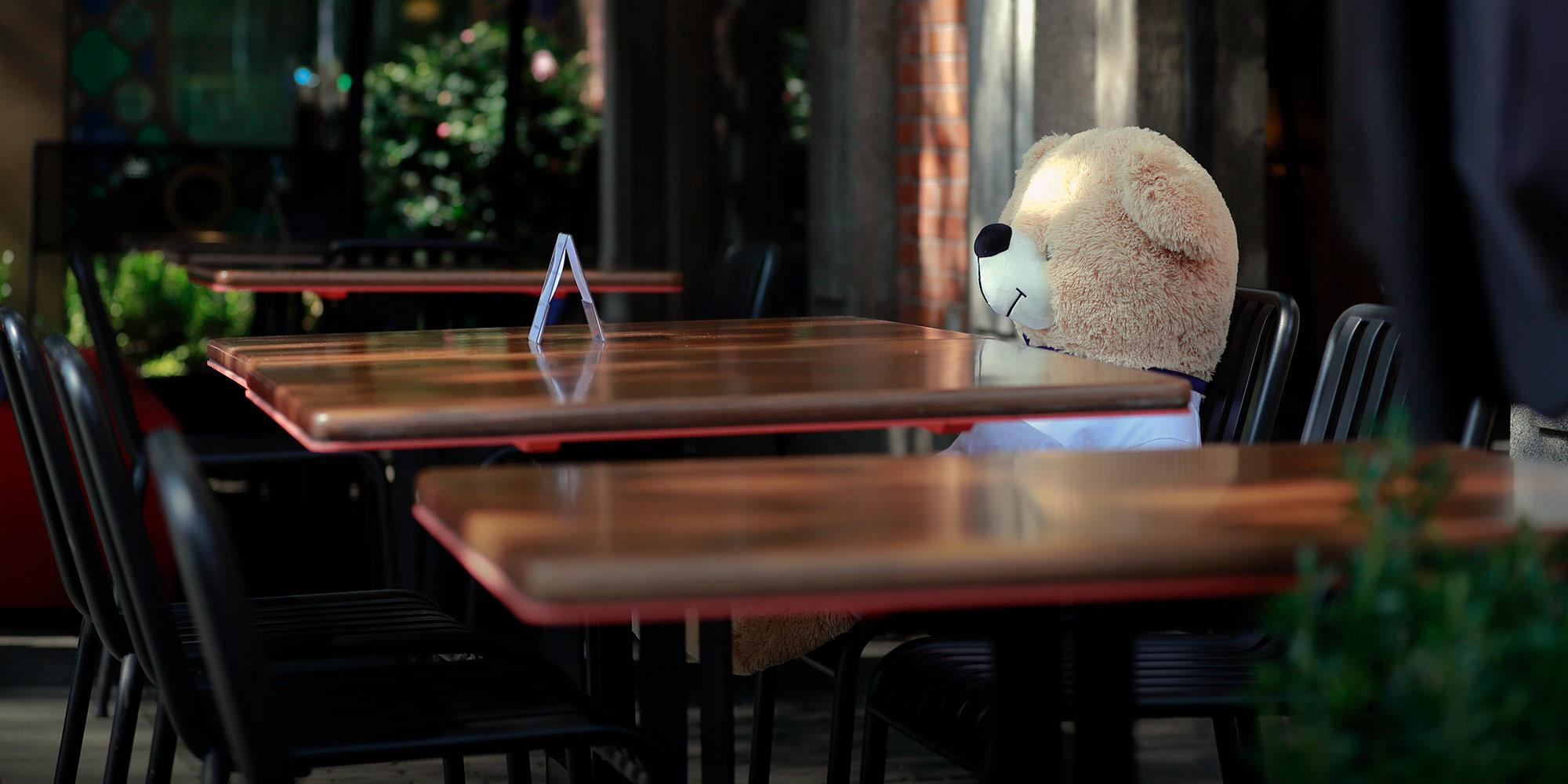 A teddy bear sits alone at a restaurant table in Shanghai, Feb. 24. Photo: Sixth Tone