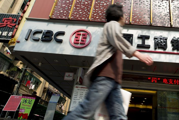 A man walks past an Industrial & Commercial Bank of China Ltd. branch in Guangzhou, Guangdong province. Photo: Bloomberg