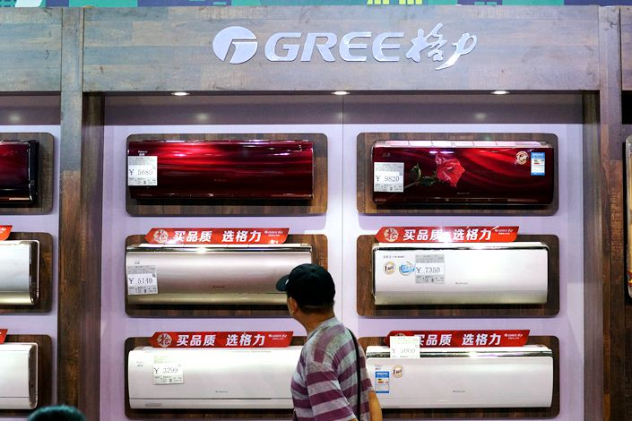 A customer takes a look at Gree air conditioner units in Tianjin in August 2020.