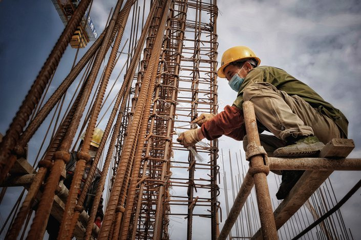 A worker at a construction site on April 26 in Putian, East China's Fujian province.