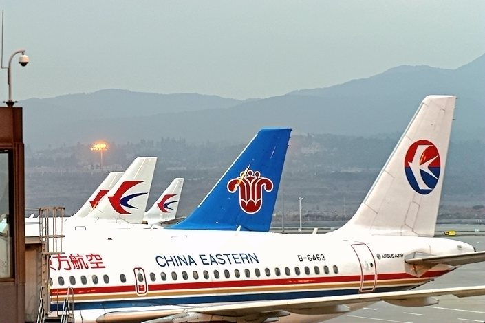 China Southern Airlines and China Eastern Airlines planes are parked at Changshui International Airport in Kunming, Southwest China's Yunnan province, on July 25.