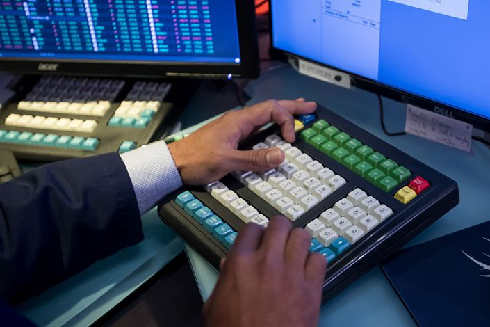 A trader works on the floor of the New York Stock Exchange. Photo: Bloomberg