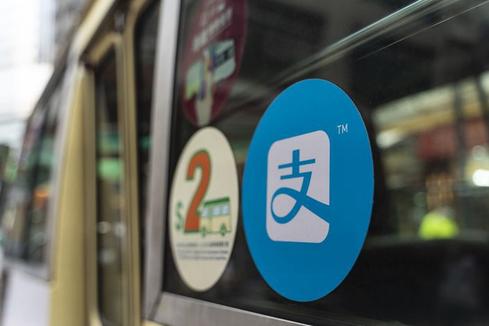 A sign for digital payment service Alipay is displayed on a public bus in Hong Kong on Tuesday. Photo: Bloomberg