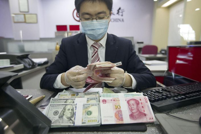 A bank worker counts money in Taiyuan, Shanxi province, March 13.