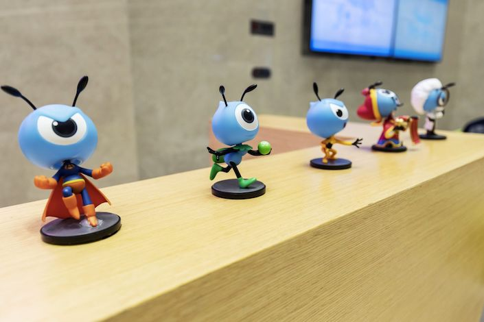 Various figurines of the mascot for Ant Financial are displayed on a reception desk in the lobby of the company's headquarters in Hangzhou