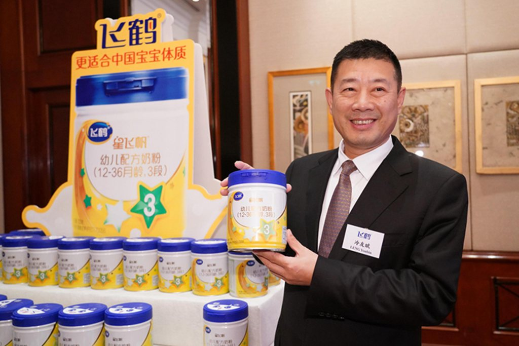 Feihe Chairman Leng Youbin attends a conference in Hong Kong on Oct. 29.