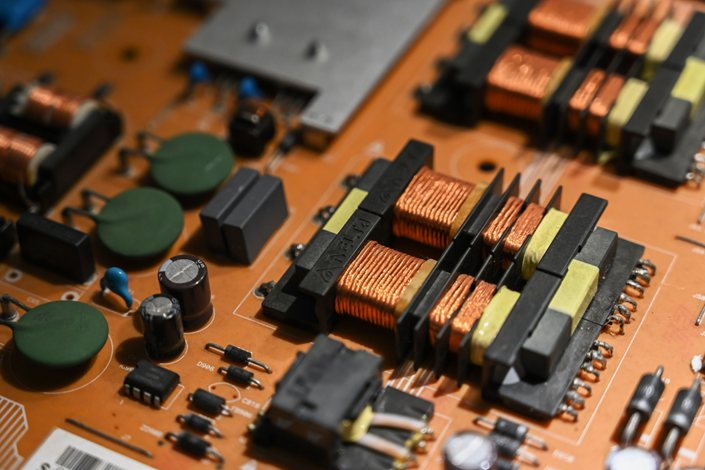 Delta Electronics Inc. components are displayed on a power supply circuit board on display in a showroom at the company's headquarters in Taipei, Taiwan, on Friday, May 3, 2019. Photo: Bloomberg