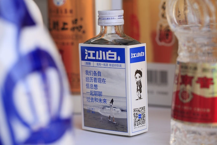 A bottle of Jiangxiaobai liquor with catchy quotes printed on its package appealing to young consumers.