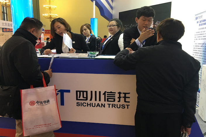 Representatives of Sichuan Trust touting their products at a financial expo in 2016.